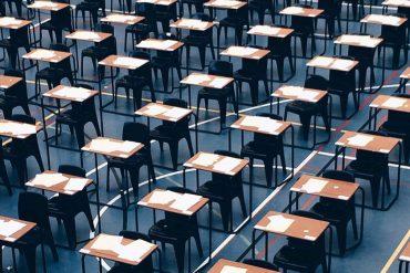 desks-set-up-in-sports-hall-for-exams_t20_v216v3