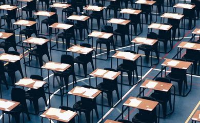 desks-set-up-in-sports-hasdfll-for-exams_t20_v216v3